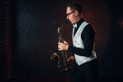 Free Male Saxophonist Playing Classical Jazz On Sax Royalty Free Stock Photo - 91926015