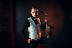 Male saxophonist posing with saxophone, jazz man Stock Image