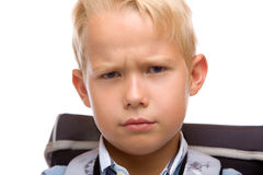 Male Schoolchild looks angry in camera. Schoolboy with satchel looks angry in camera. Isolated on white Stock Photography