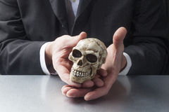 Male scientist displaying a skull Stock Photo