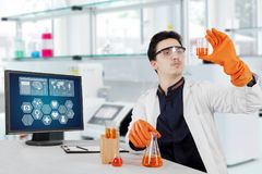Male scientist doing chemical research. Male scientist doing science research in laboratory Royalty Free Stock Photo