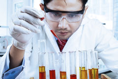 Male scientist doing research in laboratory. Asian scientist wearing lab coat and instruments research in modern laboratory Stock Photos