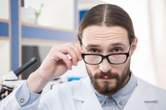 Male scientist in eyeglasses Stock Image
