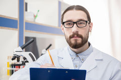Male scientist in eyeglasses Stock Images