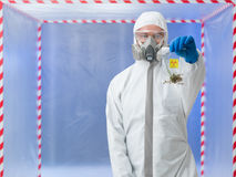 Male scientist holding bag with biohazard symbol Royalty Free Stock Image