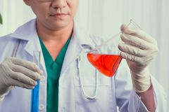 Male scientist holds and examine samples.  Royalty Free Stock Photos