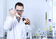 Male scientist with laboratory pipettes Royalty Free Stock Photos