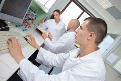 Male scientist makes chemical experiments in lab. Male scientist makes chemical experiments in the lab Stock Images