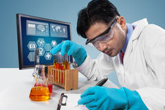 Male scientist makes experiment result Stock Photography