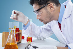 Male scientist making experiment. With chemical fluid in the laboratory Stock Photo