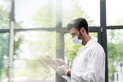 Male scientist in protective workwear using digital tablet Royalty Free Stock Photos