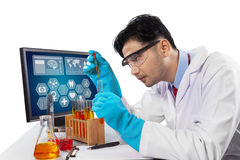 Male scientist student doing research. Young scientist student using chemical fluid for research, isolated on white Stock Image