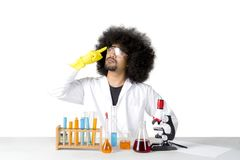 Male scientist thinking his new research on studio. Image of Afro male scientist thinking his new research, isolated on white background Stock Photo
