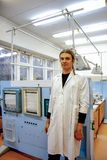Male scientist in white robe working in laboratory of plant physiology.  royalty free stock photo