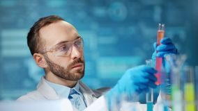 Male scientist worker making pharmacology substance using beaker at digital lights background