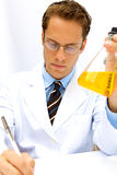 Male Scientist working in a Lab. A male scientist working in a lab with glasses Royalty Free Stock Image