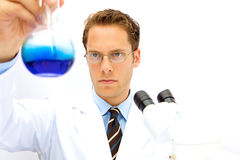 Male Scientist working in a Lab. A male scientist working in a lab with glasses Stock Photography