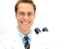 Male Scientist working in a Lab. A male scientist working in a lab with glasses Royalty Free Stock Photo