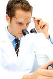 Male Scientist working in a Lab. A male scientist working in a lab with glasses Stock Images