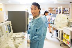 Male Scientist Working In Laboratory. Portrait of male scientist with colleague working in laboratory Stock Photos