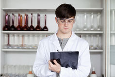 Male scientist writing on a clipboard Stock Photography