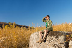Male Scout on Rock Watching the Wide Landscape Royalty Free Stock Photos