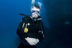 Male scuba diver. Top body shot of male scuba diver underwater Royalty Free Stock Photography