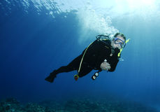 Male scuba diver. Man scuba diving in clear blue water Royalty Free Stock Photo