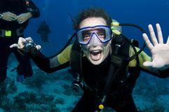 Male scuba diver. Scuba diver smiles underwater and has fun Royalty Free Stock Photos