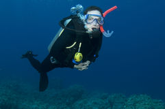 Male scuba diver. Man, scuba diving in clear blue water Royalty Free Stock Photos