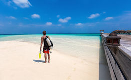 Male scuba diver on the beach. At the Maldives Royalty Free Stock Image