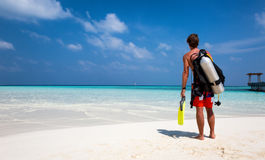 Male scuba diver with equipment on the beach. In the Maldives Royalty Free Stock Photo