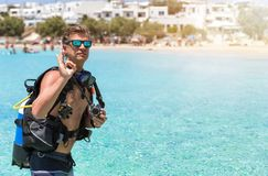 Male scuba diver showing the OK sign. Male scuba diver in front of turquoise waters showing the OK sign Stock Photography