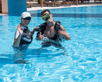 Male Scuba Diver. Paliouri,Greece - June 15 2016: Young  man tries a scuba dive in a pool with an instructor.Scuba diving is a fun sport enjoyed by many people Stock Images