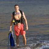 A male scuba diver returning to the shore Royalty Free Stock Photography