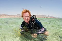 Male scuba diver on surface Royalty Free Stock Photo