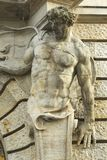 Male sculpture as decoration of the facade. Of the old building Royalty Free Stock Images
