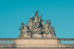 Male sculptures with weapons on historic building Royalty Free Stock Photos