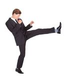 Male Secret Agent Fighting. Young Man In Black Suit Kicking On White Background Royalty Free Stock Images