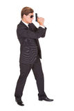 Male Secret Agent Holding Gun. Young Man In Black Suit Holding A Gun On White Background Stock Photo