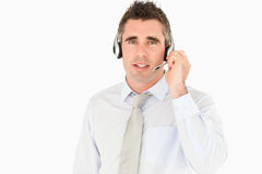 Male secretary speaking through a headset. Against a white background Stock Photos