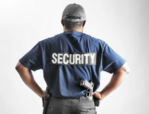 Male security guard. On light background Stock Photo