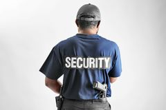 Male security guard. On light background Royalty Free Stock Photography