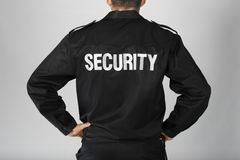 Male security guard on light background,. Closeup Stock Photos