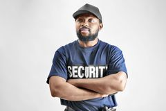 Male security guard. On light background Stock Photography