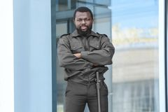 Male security guard near big   building. Male security guard near big modern building Royalty Free Stock Photos