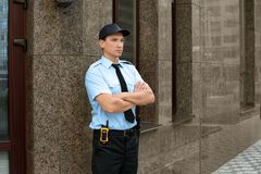 Male security guard near building,. Outdoors Stock Image