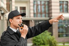 Male security guard with portable radio,. Outdoors Royalty Free Stock Photo