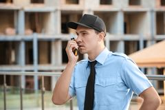 Male security guard with portable radio,. Outdoors Royalty Free Stock Photos