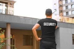 Male security guard with portable radio,. Outdoors Stock Image